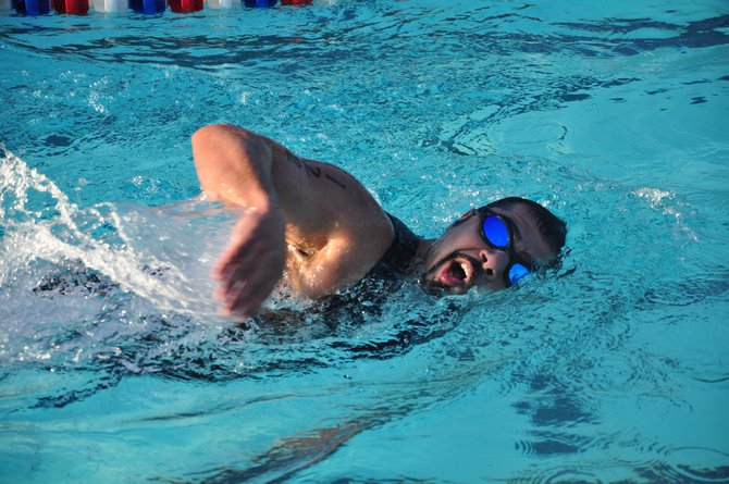 Robert Marzban competes in the quarter-mile swim, the first part of the Reston Sprint Triathlon Sunday, June 3 at the Lake Newport Pool.
