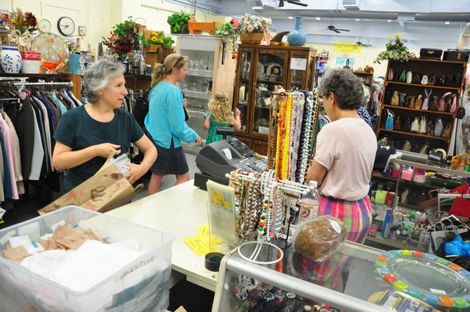 Volunteers at The Closet in Herndon will open the nonprofit thrift store the last Thursday evening of each month to try to attract more shoppers.