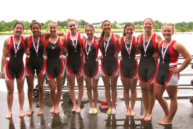 Members of the T.C. Williams girls' varsity 8 stand arm-in-arm on the medal dock after winning the bronze medal in the finals of the 67th Canadian Secondary Schools Rowing Association Regatta in St. Catharines, Ontario on June 3. Members of the girls' varsity 8 include (from left): Jackie Tilley, Gabriella Salcedo, Caroline Olsson, Kate Banchoff, Rosa Procaccino, Nadia Magallon, Kate Arnold, Katie Pickup, and Alexandria Lemke.