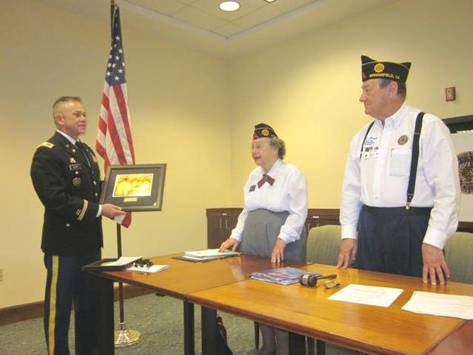 During a visit to Greenspring Retirement Village in April, U.S. Army Col. David J. Clark, chairman of the 60th Korean War anniversary committee, presents a commemoration plaque to Libby Haynes and Peter Straub, a Greenspring resident and Vice Commander of American Legion Greenspring Post 123. Haynes is the Adjutant and treasurer for the American Legion Greenspring Post 123. Other residents who received certificates for their service in the Korean War were: Wanda Driver, Dureta Wiecjorek, Mary Cormier, Jane Ford, Gail Reals, and Margaret Brewer.