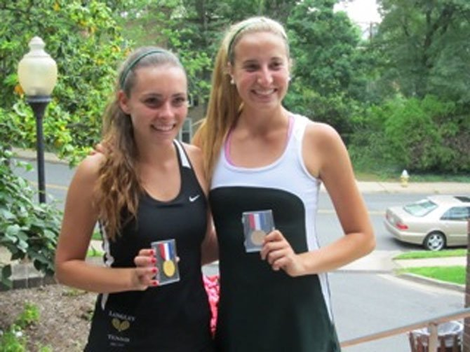 Langley High girls&#39; tennis players Sydney Goodson and Kathryn Emery teamed up to win this spring&#39;s Northern Region doubles tournament championship. Here, the winning teammates display their championship medals.