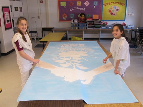 Churchill Road sixth graders Emma Higbee and Maggie Bujor work on the initial design for the schools environmental studies banner. (Not pictured Linsey Wenk).