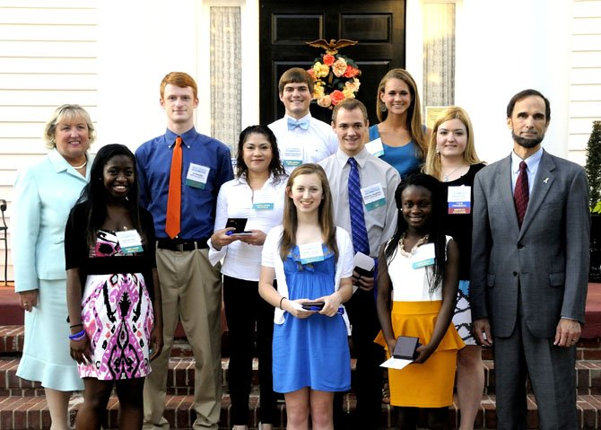 Barbara Doyle with scholarship recipients, Erika Saravia, Bryant High School; Joseph Fitzsimmons, Hayfield Secondary School; Rachelle Powell, Hayfield Secondary School; Ian McKellips, Mount Vernon High School; Valerie Manu, Mount Vernon High School; Benjamin Dougherty, Thomas A. Edison High School; Abigail Jacobs, West Potomac High School; Sarah Jane Underwood, West Potomac High School; along with Ashley McNeff, Chamber vice president, and Dan Storck, Fairfax County Public School Board member.