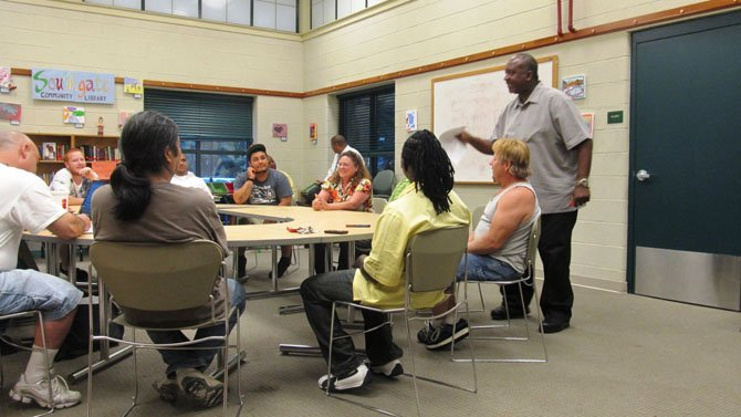 Social worker Calvin Robertson, with Fairfax County's Department of Family Services, teaches the Fathers in Touch class at South Gate Community Center in Reston. The 12-week program, a partnership with Fairfax County and the Capital Youth Empowerment Program (CYEP) in Alexandria, helps men become more engaged and loving fathers.