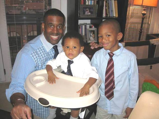 Moses Eric Cobb with sons Barron, 2, and Bryce, 7.