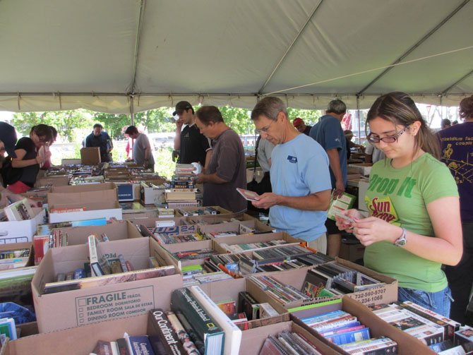 Thousands and thousands of books, representing every genre, were organized for browsing. People come to the annual Historic Vienna, Inc. book fair from all over the region, but, especially, from Vienna. Neighbors run into one another there.