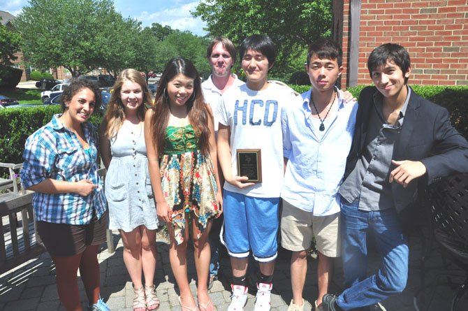 From left, Langley High School junior Rana Halabi, senior Heini Korhonen, junior Jessica Zheng, teacher Chris Bass, senior Brian Chung, sophomore Tony Zheng and sophomore Jeff Waters, members of the Langley High School Community Service club. Chung was named the club's first ever Volunteer of the Year. Not pictured: senior Lizz Gentry and junior Brittany Kim.