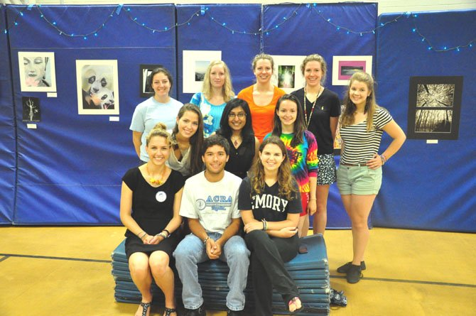 Students at Langley High School prepare an art show Saturday, June 9 to raise money for the Gandhi Brigade, a Maryland-based charity.