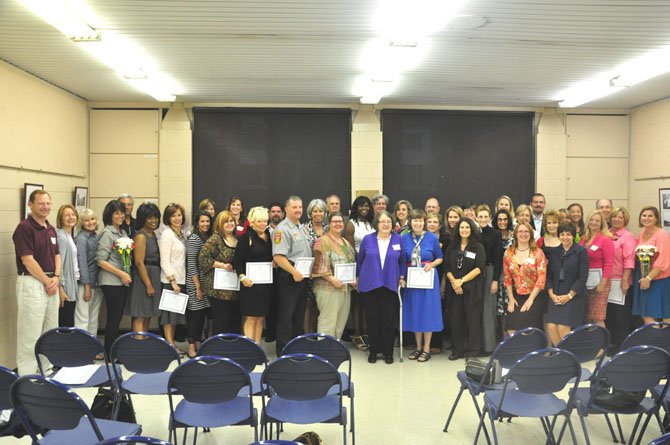 Partners of the Safe Community Coalition, which includes schools, businesses, faith communities and government and safety workers, are recognized at the SCC's annual members meeting at the McLean Community Center Tuesday, June 5.