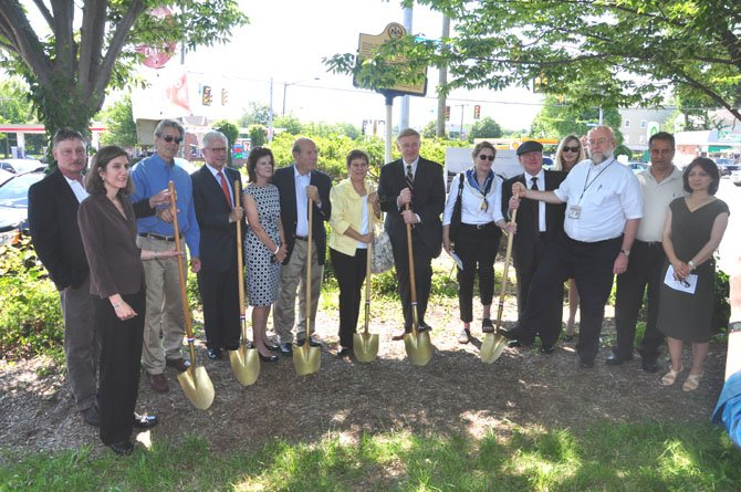 Local officials and landowners break ground on the downtown McLean project to place all overhead utilities at the intersection of Old Dominion Drive and Chain Bridge Road underground Thursday, June 7.
