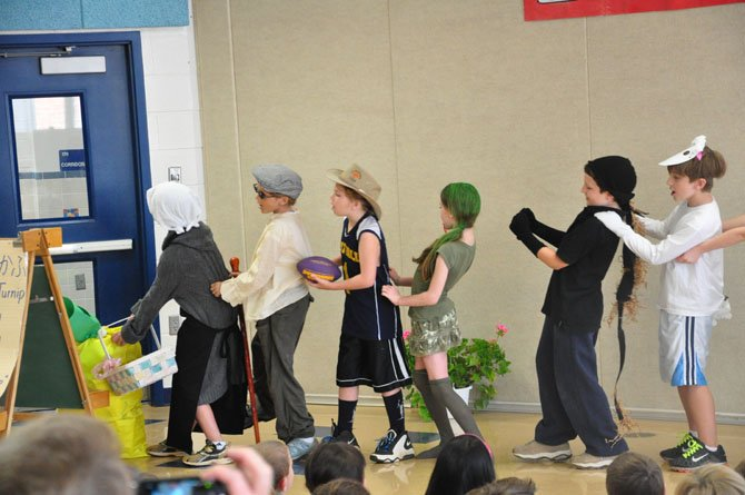 "Third graders in the Japanese Immersion Program at Great Falls Elementary School present the play ""The Enormous Turnip"" as part of their end-of-the-year celebration Friday, June 8."