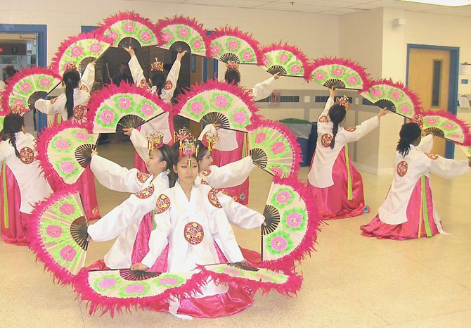 Students perform a Korean fan dance during the Fairfax Academy's Creative Works Showcase.