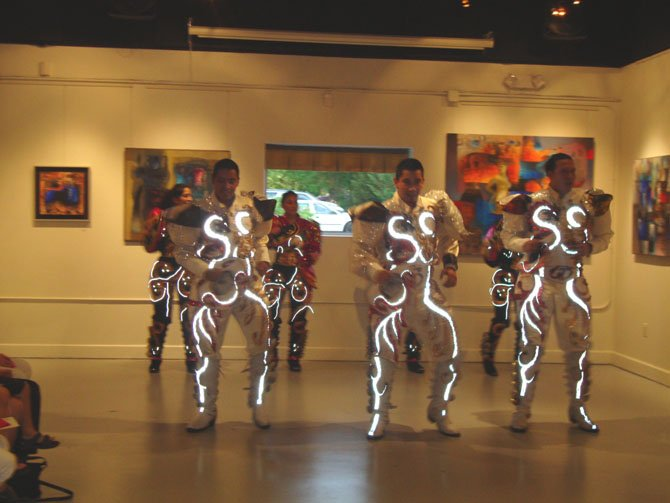 Bolivian Dance group, Caporales San Simon performing in the gallery.