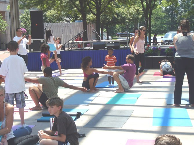 Instructor from Bikram of Great Falls teaching Bikram to patrons at the event.