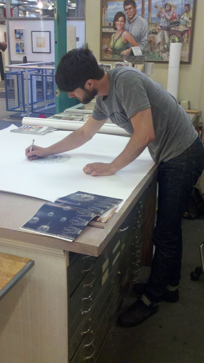 Arlington resident Joseph Shetler prepares work for display. Shetler is one of a select group of artists who will take part in the juried Visiting Artist Program at the Torpedo Factory Art Center in Alexandria.