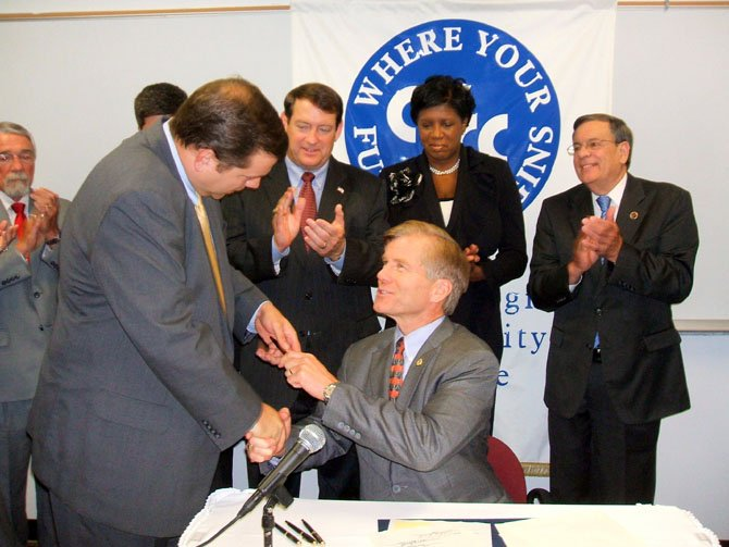Gov. Robert F. McDonnell sat bill signing to reduce or repeal unfunded mandates on local government.