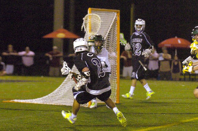 Langley goalie Andrew Spivey tries to anticipate the next move by Chantilly senior midfielder Cole Fitzgerald (2) during Saturday night's state finals lacrosse game at Westfield.