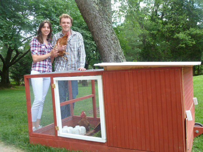 Tyler Phillips and Diana Samata build chicken coops and rent them.