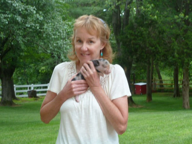 Jill Phillips with one of the petting zoo animals.
