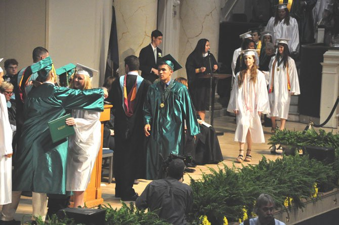 Members of the Langley Class of 2012 receive their diplomas at DAR Constitution Hall Thursday, June 14.