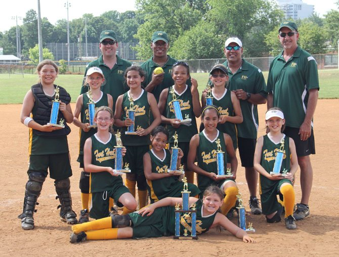 Members of the Fort Hunt 10U All Star Team. Prone: Scarlett Anderson, kneeling, from left, Megan Huck, Nekia Aiken, Sophia Castillo, Farrin McMaster, standing, from left, Jennavieve Miller, Maggie Daly, Caroline Magro, Tiffany Stowers, Claire Davidson, and back row from left, John Daly, Craig Stowers, John Castillo and Daryl Davidson. Not pictured is 10U all-star Leia Surovell.