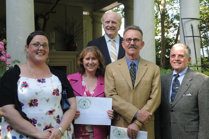 Erin Adams (Lee-Fendall House Museum and Garden), Gretchen Bulova (Stabler-Leadbeater Apothocary Shop), William V. Brierre,Jr. (Alexandria Library Company) and Al Cox (City of Alexandria) pose for a photo with HAF president Dr. D. Morgan Delaney after the presentation of grants.