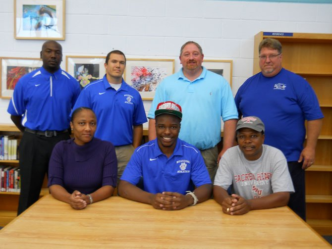 Pictured from left: Sandra Hooks (mother), TaMaric Wilson, Stacey Wilson (father), coach Chad Louisville, coach Justin Gaudenzi, DSA Aaron Helmick, coach Eric Henderson.