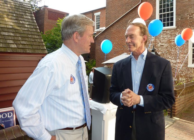 Republican candidate for City Council Bob Wood, left, talks with Michael Sauls at his campaign kick-off event June 14 in the Gadsby's Tavern courtyard.