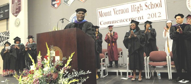 Commencement speaker, Col. Gregory D. Gadson, a bilateral above-the-knee amputee resulting from injuries sustained in a roadside bombing in the Iraq War, receives a standing ovation from the students and guests at the Mount Vernon High School 2012 Commencement Exercises on Friday afternoon, June 15 at the high school. Gadson said nothing made him prouder on this day than the perseverance of his graduating son, Jaelan. Gadson has served in the U.S. Army for more than 20 years as a field artillery officer and on active service for; Desert Shield/Desert Storm (Kuwait), Operation Joint Forge, Bosnia, Afghanistan and Operation Iraqi Freedom. While serving in the U.S. Army he has been awarded 3 Bronze Stars, a Purple Heart, Meritorious Service Medal and the Army Commendation Medal.