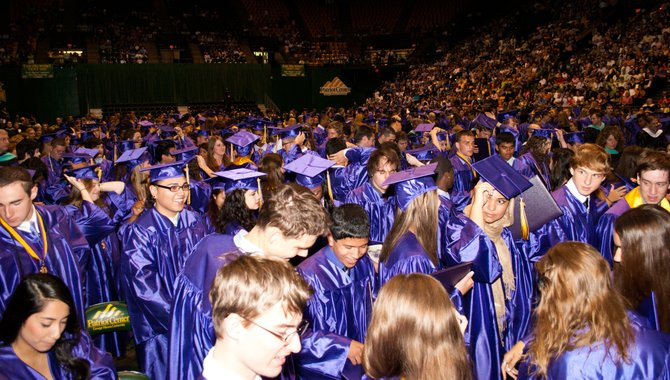 "A sea of purple as graduate candidates officials become graduates of Lake Braddock Secondary School after Senior Class Vice President Majd Hosein instructs them to ""turn their tassels"" during the Class of 2012 graduation ceremony June 15 at The Patriot Center on the George Mason University campus."
