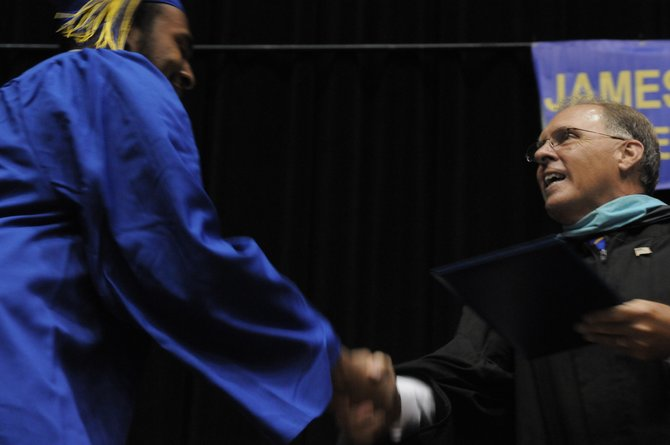 Principal Daniel F. Meier presents the diplomas to Robinson's Class of 2012 on June 14.