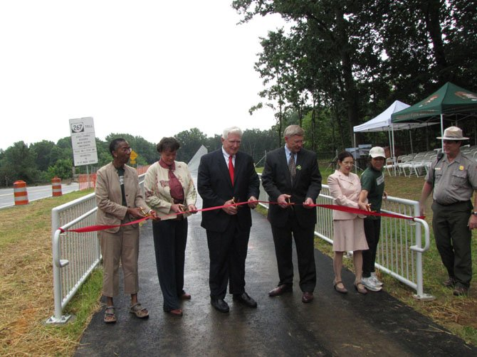 U.S. Rep. Jim Moran joins local and state officials, community advocates for ribbon cutting.