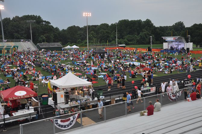 Local residents gather at Langley High School for the annual McLean Community Center fireworks show. Gates will open at this year's event at 8 p.m. July 4.