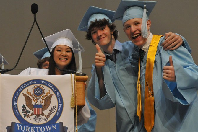 Class president Ryan Carroll and valedictorian speaker Kelly Cook and class secretary Jane Enkhbold look over the stage at Constitution Hall before the ceremony on Wednesday afternoon.