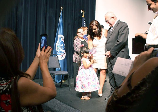 Connolly meets with new citizens after the naturalization ceremony on June 22.