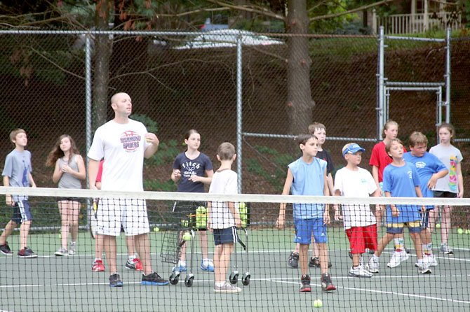 "Coach Rob leads a game of ""King of The Court"" during a junior tennis clinic at Fairfax Station Swim and Tennis Club."