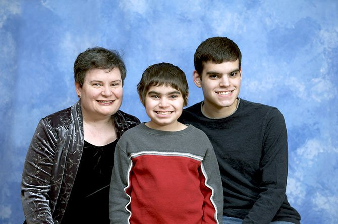 From left are Carmen Justiniano and sons Natanael and Jose in May.