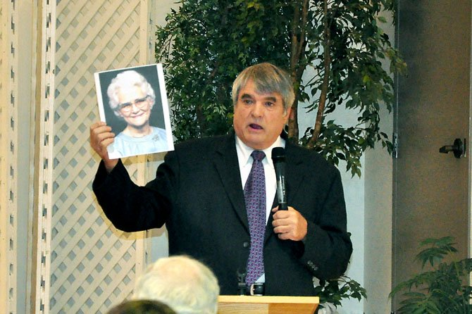 Bill Pelke, co-founder and president of Journey to Hope, an anti-capital punishment organization, holds a picture of his grandmother, who was murdered in 1985. Pelke and other speakers that have been affected by the death penalty spoke at St. John Neumann Catholic Church Monday, June 25.