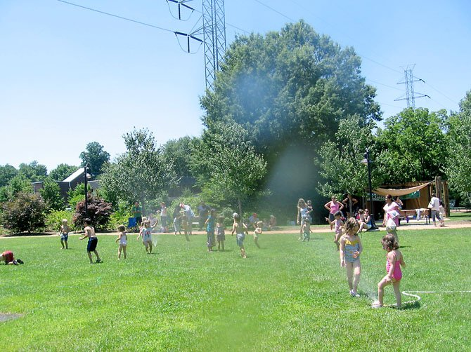 Stories and sprinklers on the Town Green in summertime draw in preschoolers and young school children.