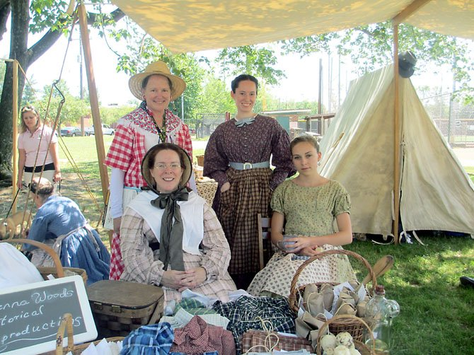 Civil War-era ladies Sherri, Hannah Yerger [front], HVI president Anne Stuntz and Rebecca Stricker, were knowledgeable and happy to describe their goods.