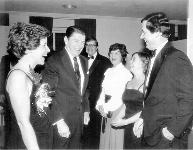 "Lou Priebe of Springfield at the 1982 inaugural of the first woman president of the National Press Club, Daily Oklahoman Assistant Bureau Chief Vivian Vahlberg. The event was attended by President Ronald Reagan. ""I had just joked that it was good to see ""the Gipper"" among this group of Oklahomans as we could use him with our ailing Sooner football team that year. He said they couldn't possibly be that desperate,"" Priebe said."