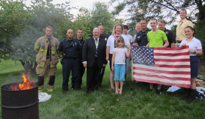 Members of the CAR, DAR and SAR retired worn and soiled United States flags with assistance of the Great Falls Volunteer Fire Department. Worn American flags of any size may be left at the Great Falls Library year-round for this annual event.