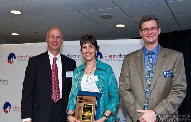 Pictured above (from left) at the 2012 Vienna Tysons Regional Chamber of Commerce Business and Service Awards are Dr. Gerald Gordon, Master of Ceremonies and President and CEO of the Economic Development Authority in Fairfax County; Michelle Scott, Executive Director of the Shepherds Center of Oakton-Vienna and recipient of the 2012 Vienna Tysons Regional Chamber of Commerce Nonprofit of the Year Award; Kevin McCoy, Board Chair of the Vienna Tysons Regional Chamber of Commerce and an attorney with Kruchko and Fries in McLean. 