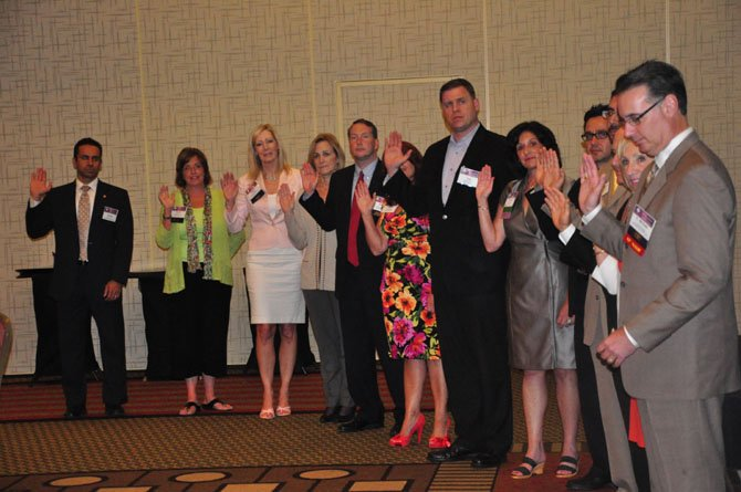 Members of the 2012-13 Greater Reston Chamber of Commerce board are sworn in Thursday, June 28 at the Hyatt Regency Reston.