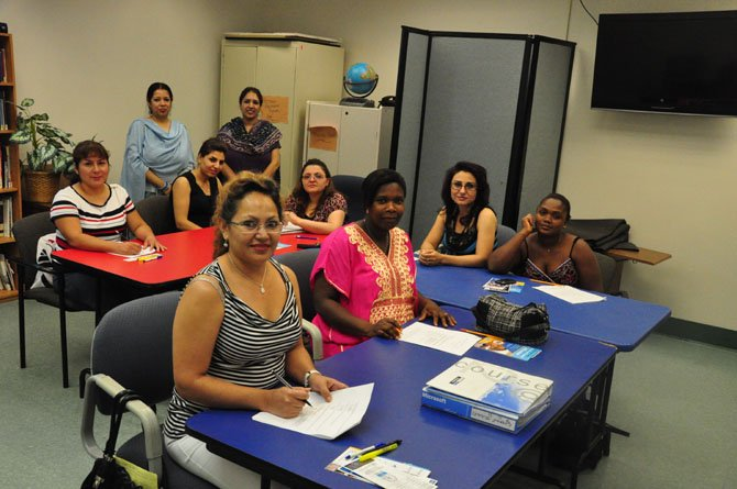 Members of Express Cares Personal Care Aide Class complete an exam at the Herndon Neighborhood Resource Center