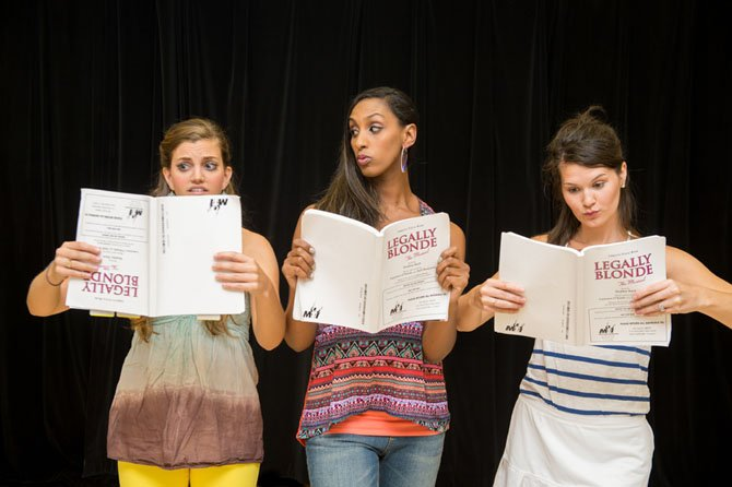 Margot (Margaret Berkowitz), Pilar (Kim Braswell) and Serena (Courtney Drake), the Greek Chorus, hitting the books.