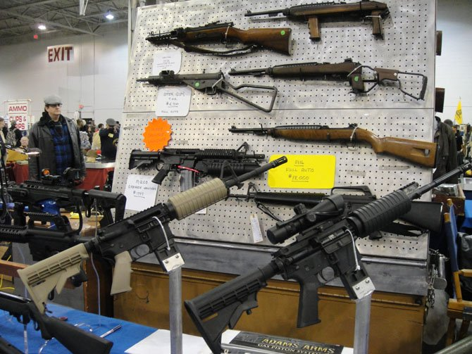 Guns on display at the Nations Gun Show. Private owners of guns in Virginia are not required to conduct background checks before selling firearms.