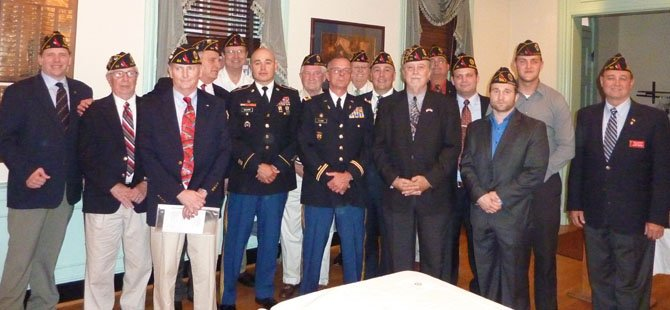 Newly installed officers and executive board members of American Legion Post 24 pose for a group photo. Pictured are: Erik Campbell, Dick Evans, Henry Dorton, Commander Bill Aramony, Jim Bertine, Jerome Schorr, Jim Taylor, Steve Flamm, Fred Brink, Mike Sawyers, Jim Glassman, Paul Moffett, Chance Wiley, Jared McMullen, Jesse Stevens and Dan Dellinger. Not pictured are Scott Allen, Doug Gurka, Warden Foley and Bill McNamara.