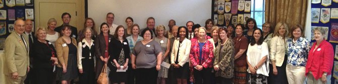 Representatives from local nonprofits gather for a group photo June 12 at the Rotary Club's annual Contributions Day. The club awarded $92,000 to 32 local organization.