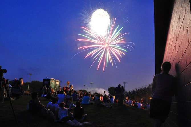 The audience watches fireworks from the bleachers at Langley High School Wednesday, July 4.
